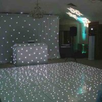White LED Booth, star cloth & Dance floor at Pennyhill Park