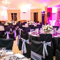 Black chair covers at Pennyhill Park Hotel